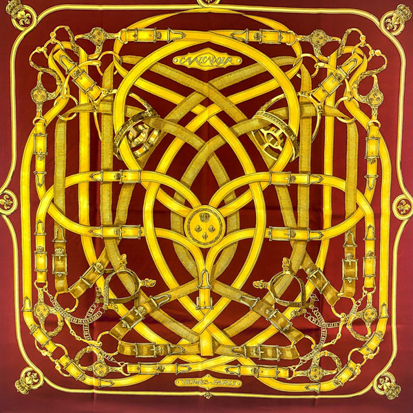 Cavalcadour Hermes Scarf in gold on bordeaux background