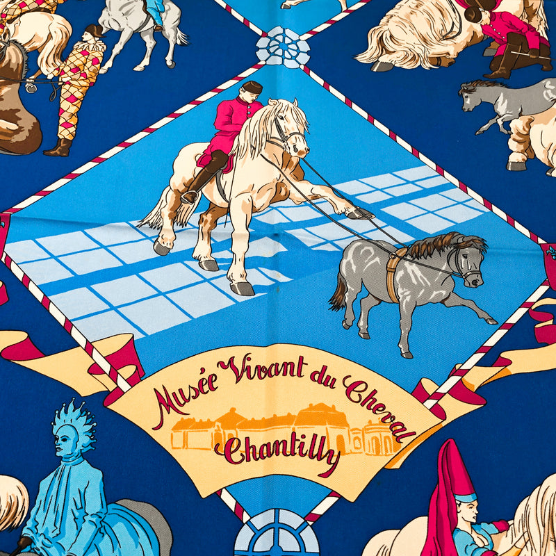 Musee Vivant du Cheval (Chantilly) Hermes scarf title close up shows spots above title