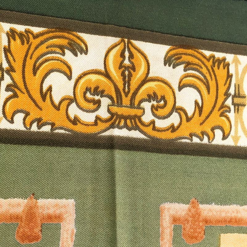 close up of fleurs de lis on upper part of scarf