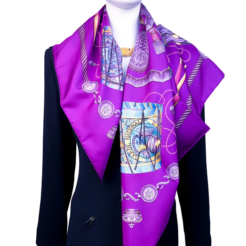 Les Tambours Hermes silk twill scarf worn over black blazer