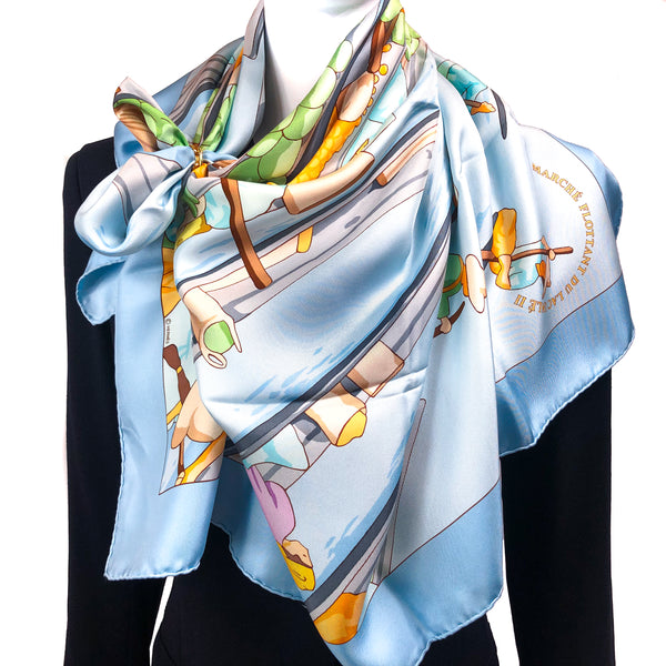 Marche Flottant du Lac Inle II Hermes silk scarf worn loosely over a black Hermes blazer