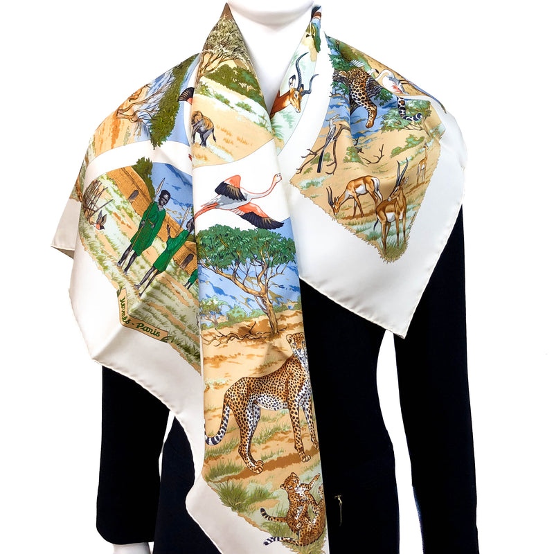 Tanzanie Hermes scarf in brown and green tones against a cream background