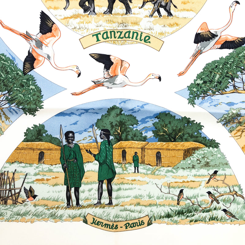 Tanzanie Herme scarf with several vignettes depicting African fauna, flora and native peoples