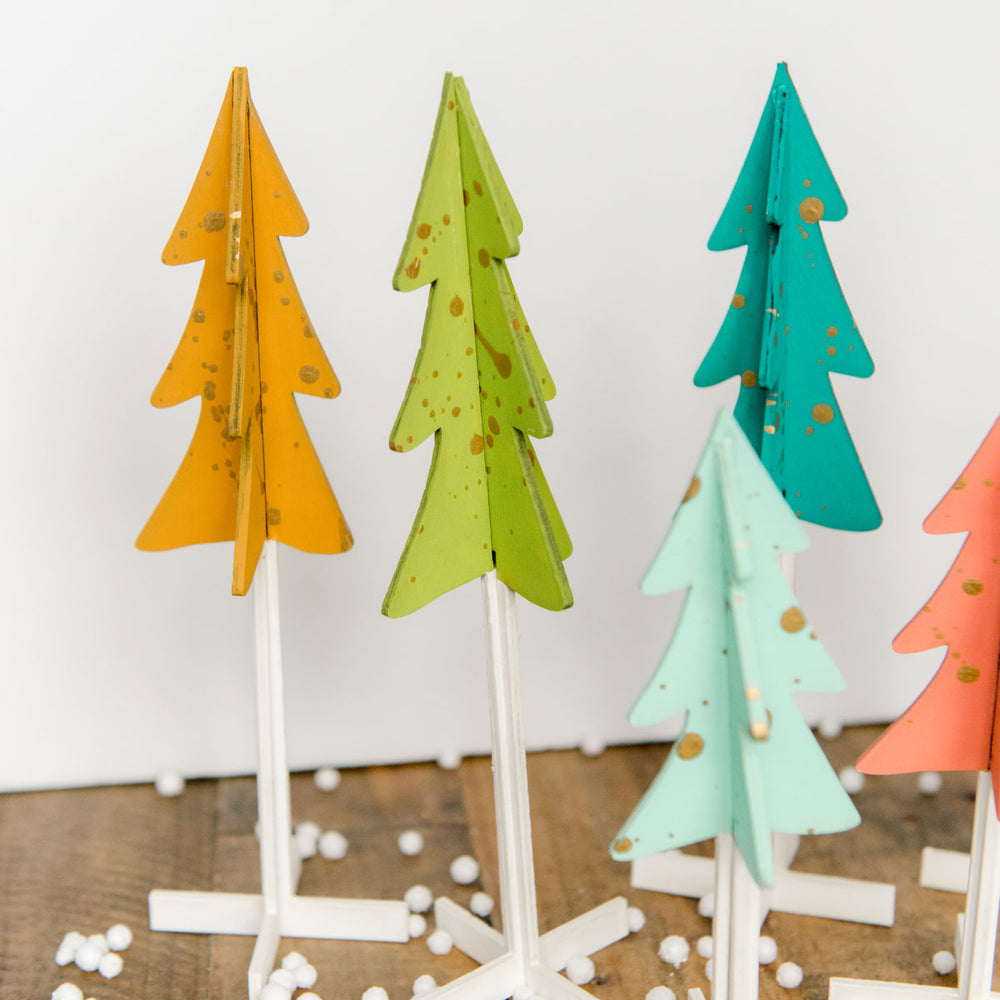 Splatter painted colorful Christmas trees