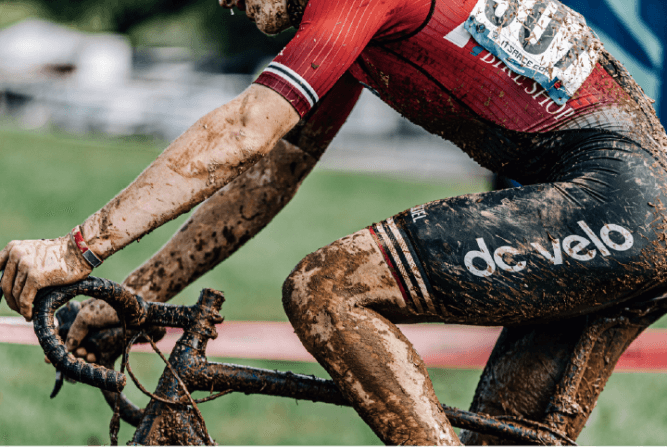 best of the best practices cyclist in custom jersey covered in mud
