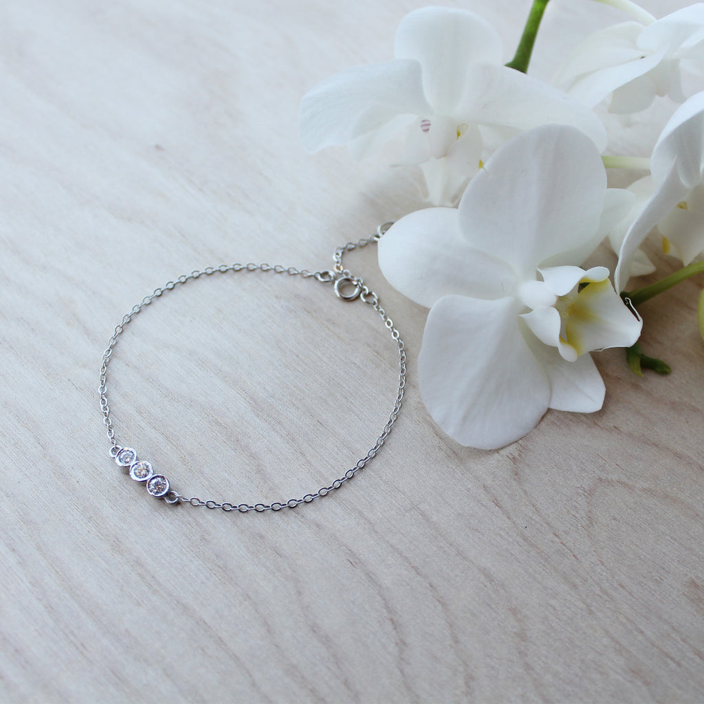 3 stone bracelet - clear diamond, white gold