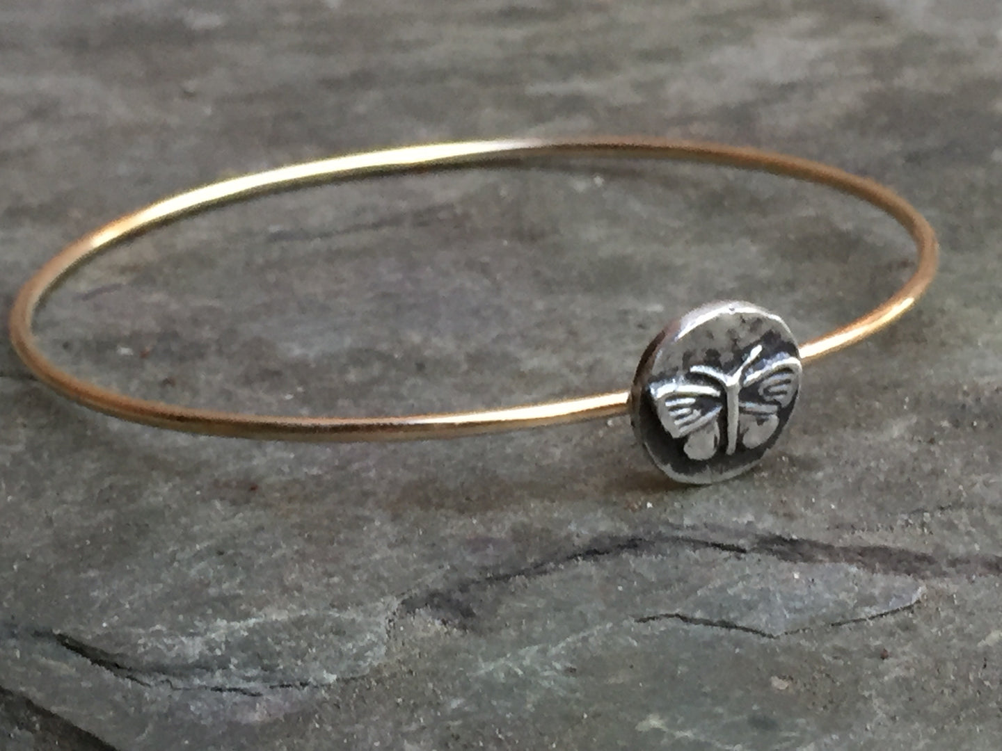 Sonya Ooten gold bangle with butterfly disk charm
