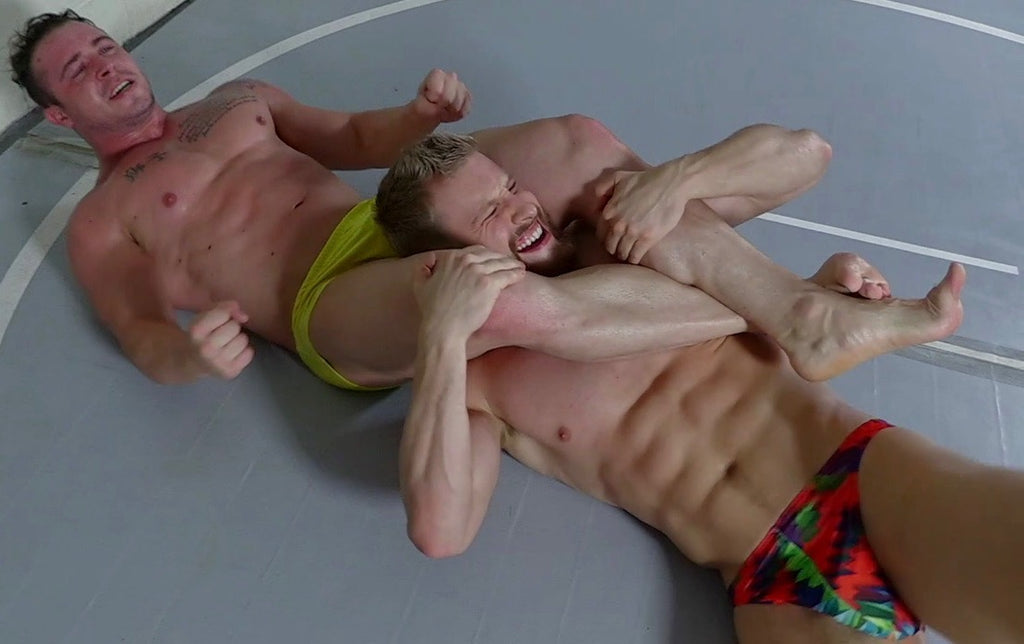 body builder in a head scissor