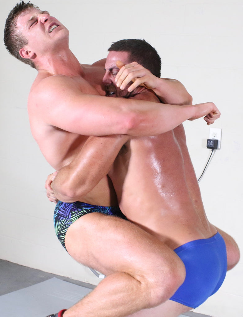body builders bear hugging each other