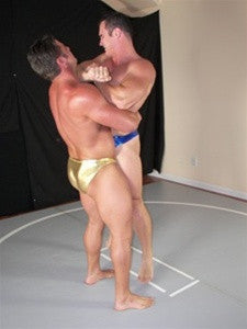 Frank the Tank and Ace Hanson showing strength and power crushing bearhug submission