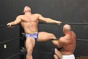 Brute leg stretch Johnny Bravo in the corner ropes big pecs thighs arms