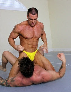 Dallas Coupe bodyscissors submission hold submit abs pecs chest