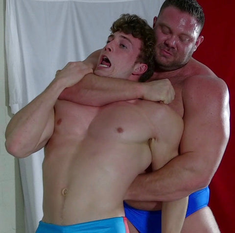body builder dominating wrestler