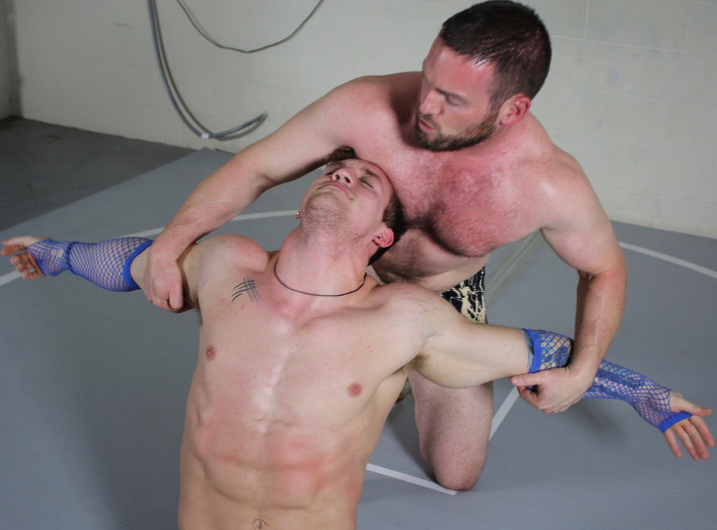 wrestler having arms pinned back