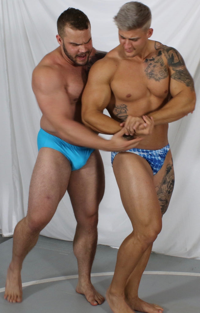 posing flexing muscles tattoos sexy biceps pecs mat wrestling