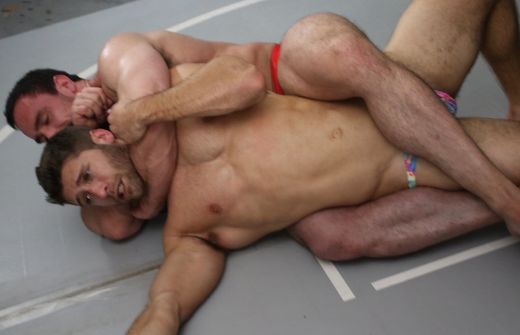 CJS puts Blayne into a body scissors while putting him in a choke hold on Thunders Arena Wrestling.