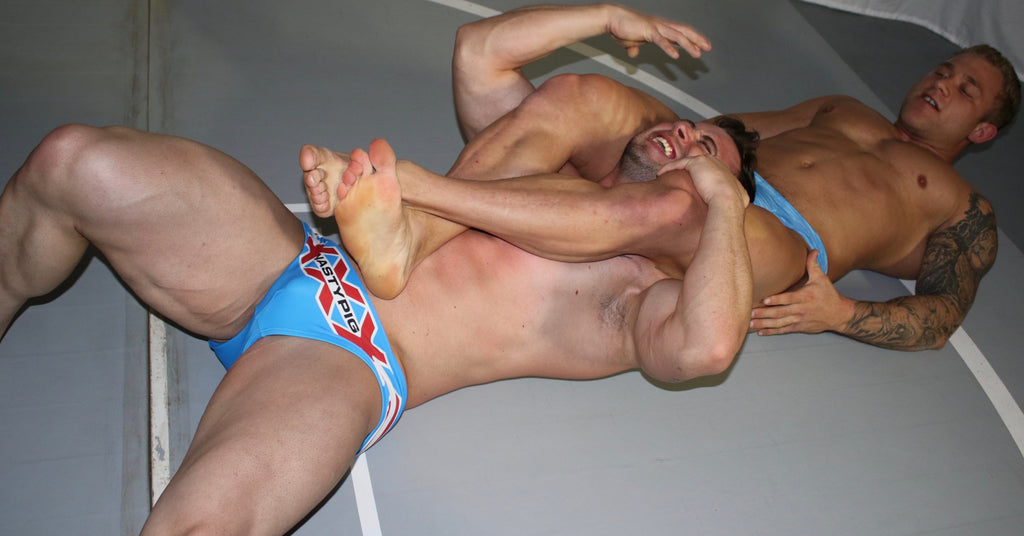 Jake puts Dom9 into a head scissors at Thunders Arena Wrestling.