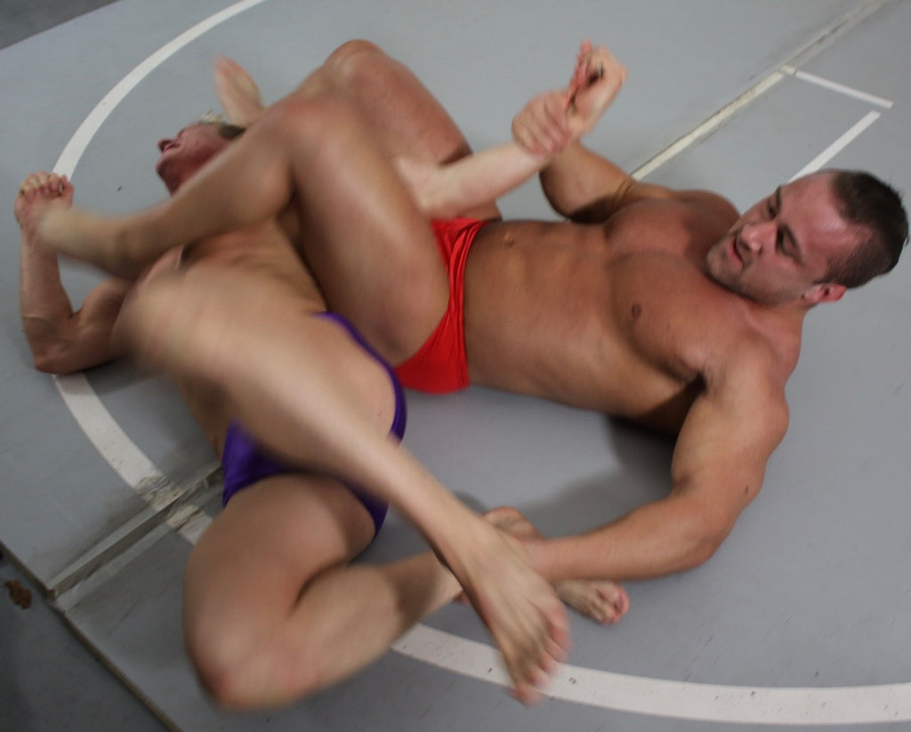 Dolf puts Bager into an armbar at Thunders Arena Wrestling