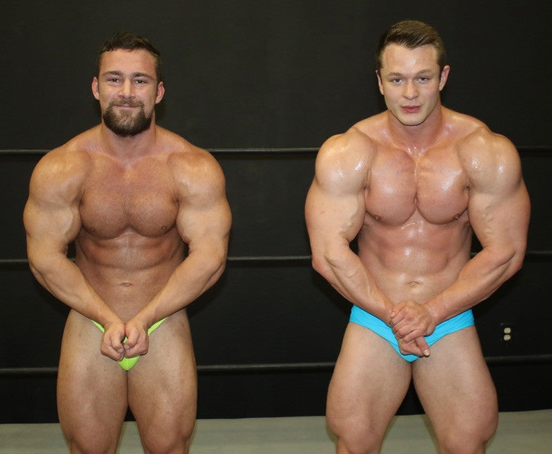 bodybuilders Dolf and Steel pose and flex their pecs in Thunders Arena