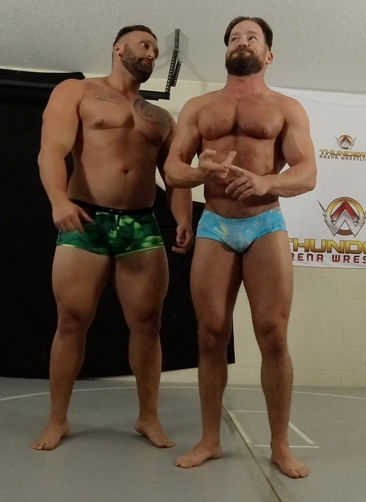 Stallion and Joey King flexing before their match