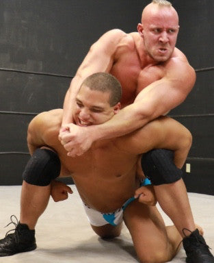 Brute camel clutch on Dozer arms pecs