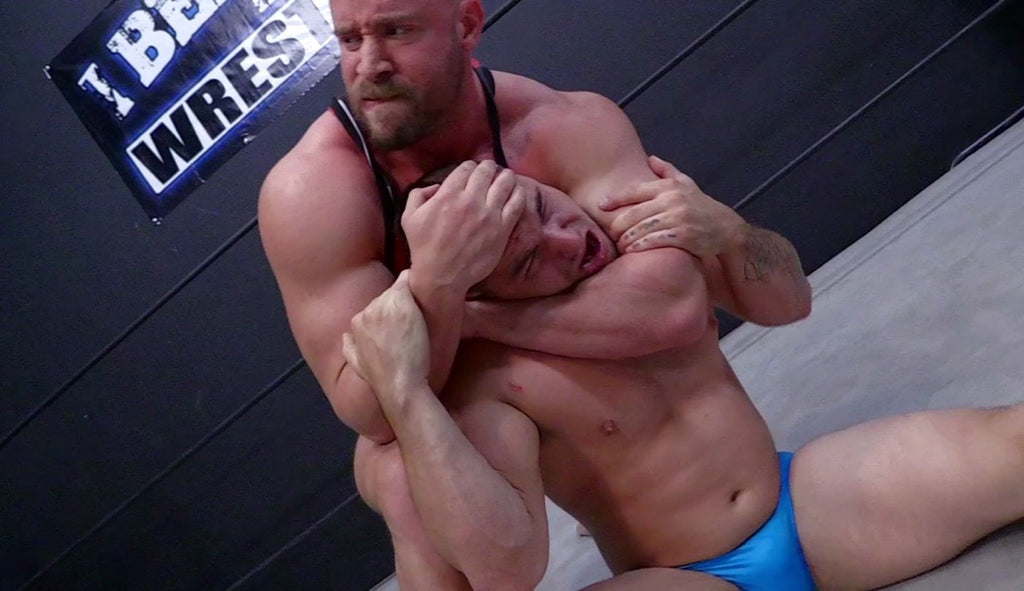 Brute puts Aspen into a sleeper at Thunders Arena Wrestling.