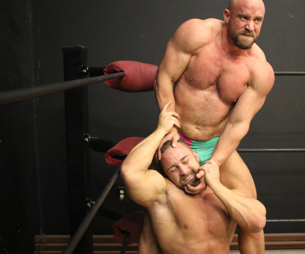wrestler dominating body builder