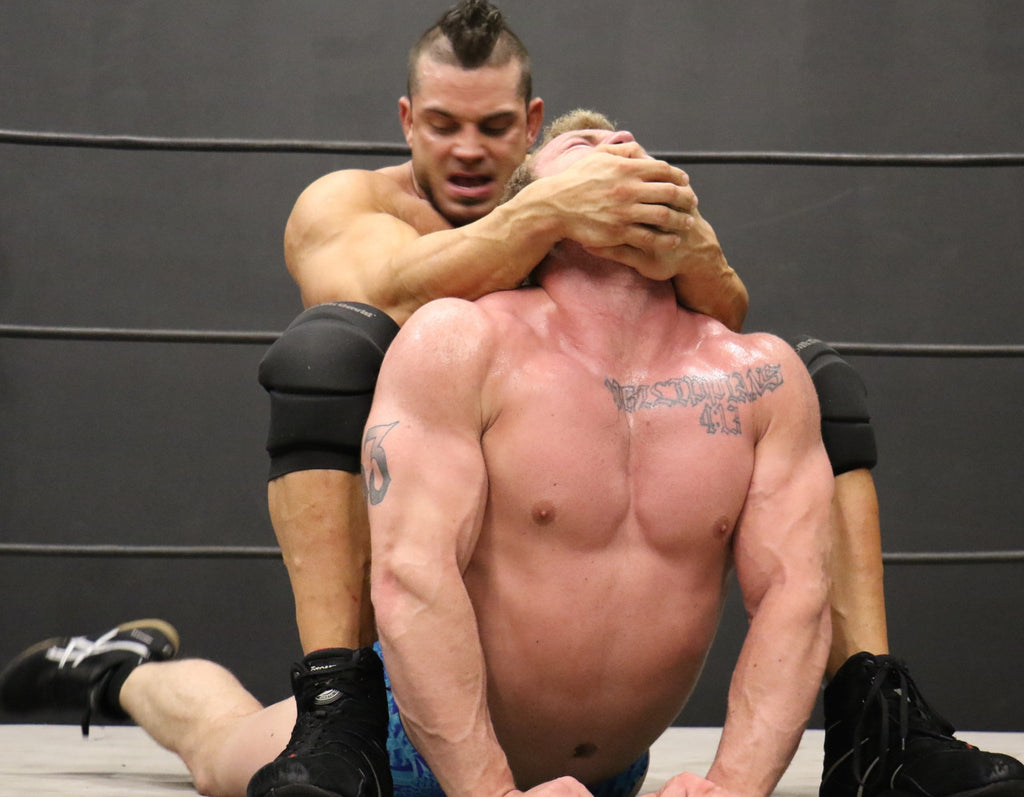 Brian Cage camel clutch on Talon biceps pecs chest