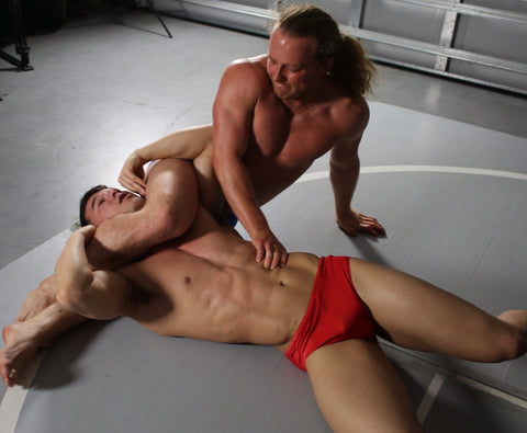Faboo puts Kasee into a head scissors at Thunders Arena Wrestling.