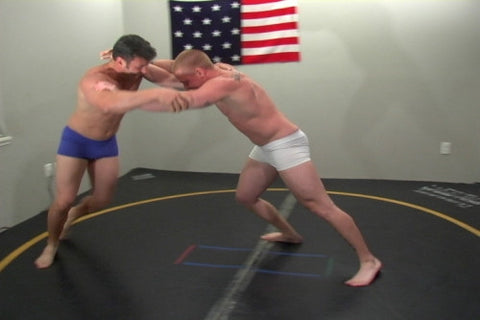 Zachary and T-bone grapple on mat legs arms