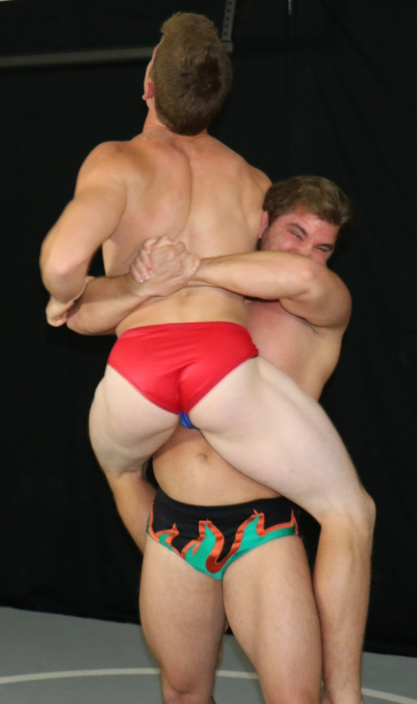 Billy the Kid grabs Scrappy in a bearhug in Thunders Arena