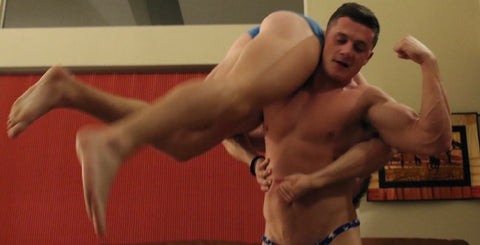 over the shoulder wrestling muscular men dominating rough ready