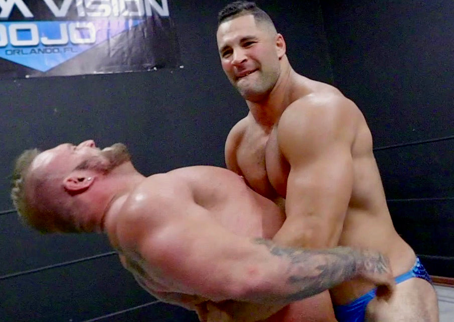 Vinny puts Gunner into a Bear hug at Thunders Arena Wrestling.