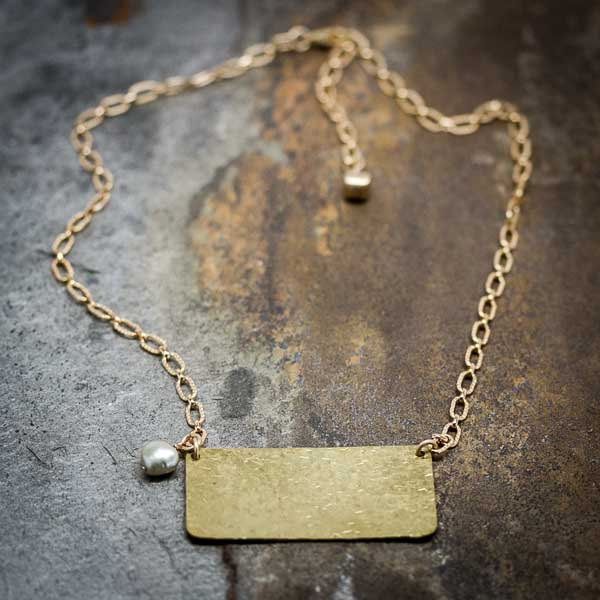 Hammered Brass with a Pearl Necklace