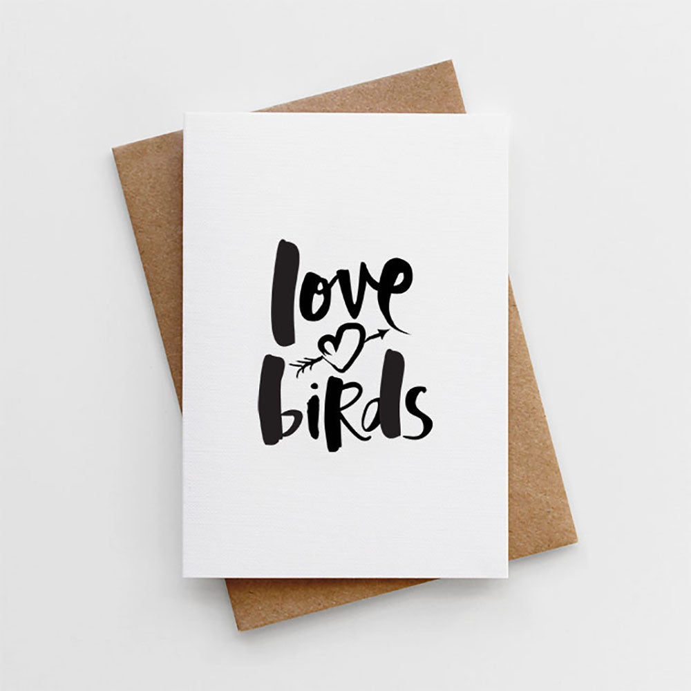 A hand lettered wedding or engagement card reading 'Love Birds'