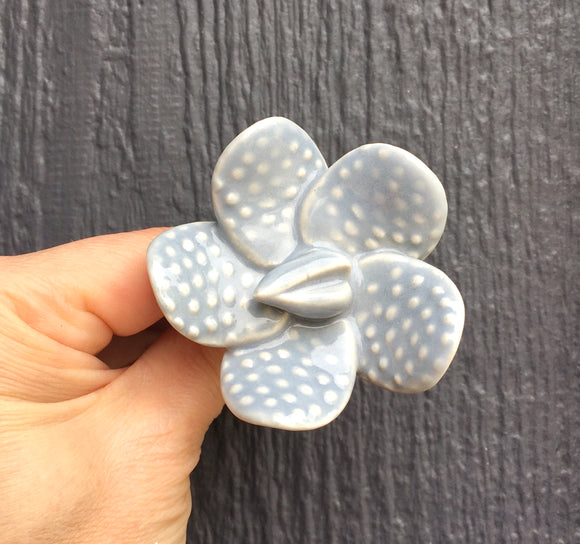 Blue/gray ceramic flower know