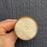 Cream carved floral + gold bone knob