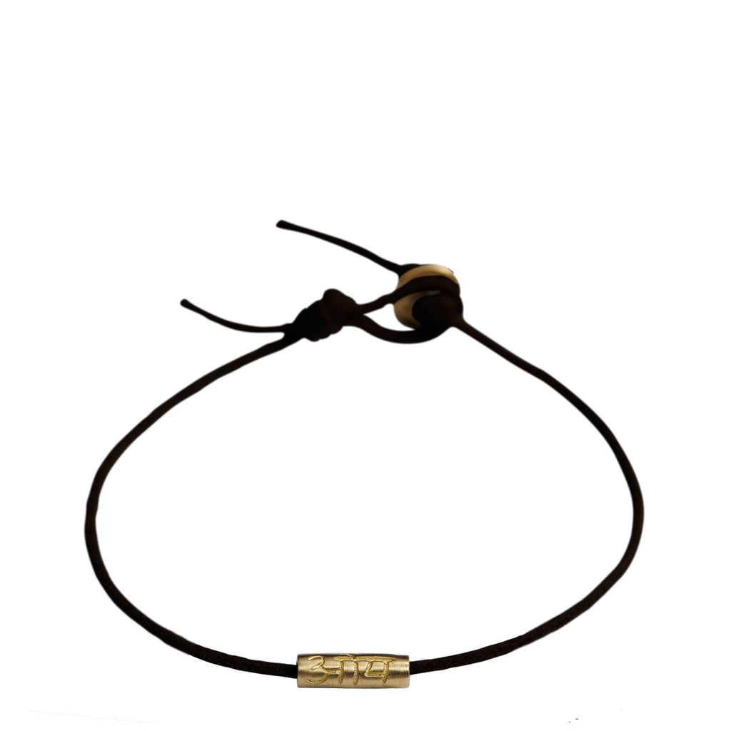 10K Gold Om Tube Bracelet on Black Cord