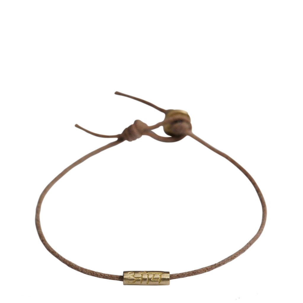 10K Gold Om Tube Bracelet on Natural Cord