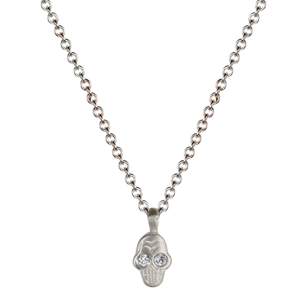 Sterling Silver Tiny Skull Pendant with White Diamond Eyes