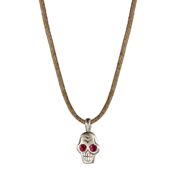 Sterling Silver Tiny Skull Pendant with Ruby Eyes on Natural Cord