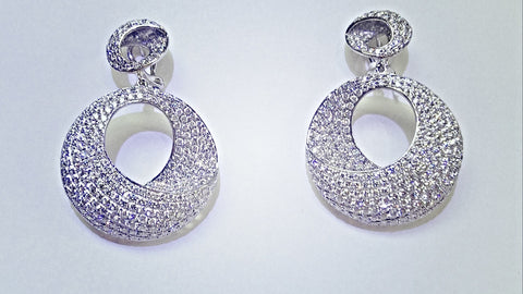 14kt white gold and diamond dangle earrings.