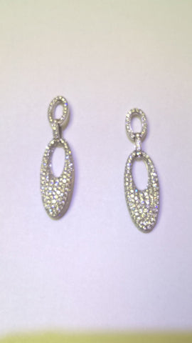 18kt white diamond dangle earrings.