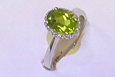 14kt white gold peridot and diamond fashion ring.