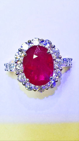 18kt white gold ruby and diamond fashion ring.