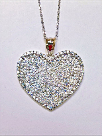 18kt white gold diamond heart pendant.