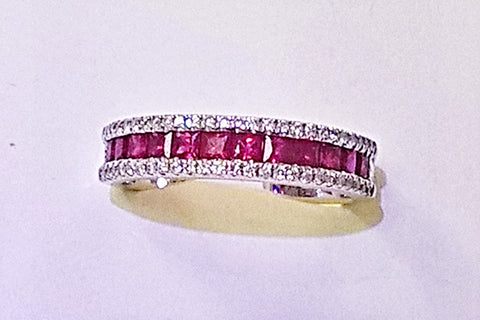 14kt white gold ruby and diamond band.