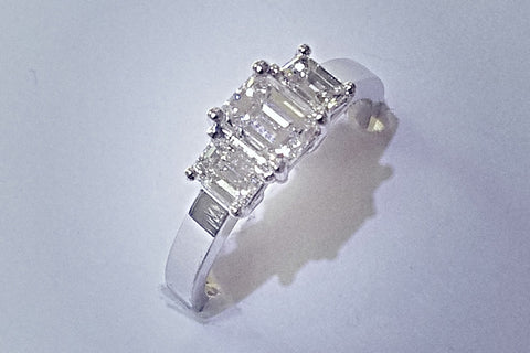 14kt white gold diamond trinity ring.