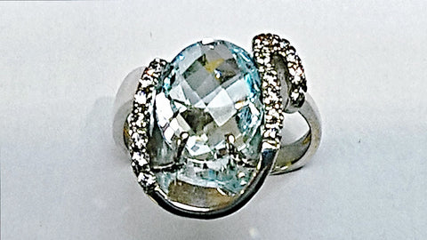 18kt white gold blue topaz and white sapphire ring.