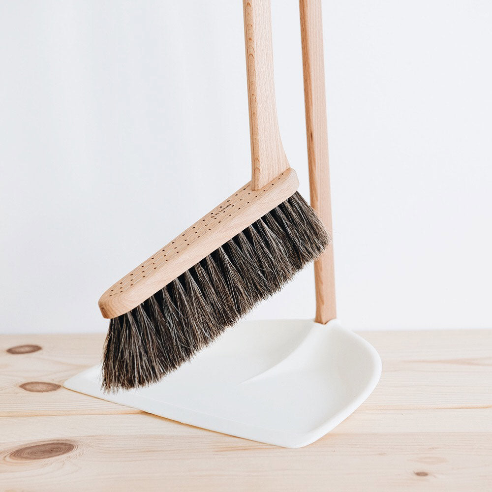 Standing broom and dustpan blue wire nuts